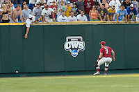 Oklahoma LF Max White fields an extra base hit in Game 10 of the NCAA Division One Men's College World Series on June 24th, 2010 at Johnny Rosenblatt Stadium in Omaha, Nebraska.  (Photo by Andrew Woolley / Four Seam Images)