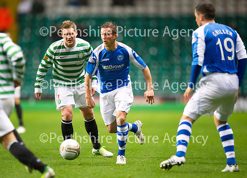 Celtic v St Johnstone...30.10.12      Scottish Communities Cup.Chris Millar tracked by Kris Commons.Picture by Graeme Hart..Copyright Perthshire Picture Agency.Tel: 01738 623350  Mobile: 07990 594431