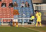 Huddersfield Town 2 Colchester United 0, 12/02/2006. Galpharm Stadium, League Two. Huddersfield Town (Andy Pandy stripes) versus Colchester United (yellow), Coca-Cola League 2 fixture at the Galpharm Stadium, which the home team won 2-0 (1-0). Picture shows the Town mascot barely able to watch as United's Kevin Watson prepares to take a first-half corner. Photo by Colin McPherson.