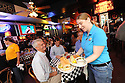 Denny Byrne gets served by waitress Megan Malone at Acme Oyster House in the French Quarter, one of the few restaurants still serving Louisiana oysters, Tuesday, July 6, 2010. Paul Rotner, director of operations, says that he is not sure how long they will last..( Photo/Cheryl Gerber)Louisiana Seafood..