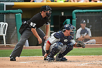 Blake Lalli (21) of the Reno Aces behind the plate with home plate umpire Adam Schwarz during the game against the Salt Lake Bees in Pacific Coast League action at Smith's Ballpark on July 23, 2014 in Salt Lake City, Utah.  (Stephen Smith/Four Seam Images)
