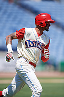 Clearwater Threshers right fielder Jose Pujols (23) runs to first base during a game against the Jupiter Hammerheads on April 11, 2018 at Spectrum Field in Clearwater, Florida.  Jupiter defeated Clearwater 6-4.  (Mike Janes/Four Seam Images)