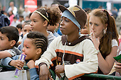 Watching young performers on stage at Church Street Summer Festival, London.