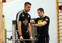 STUART JAMES STORY<br /> Pictured: Lukasz Fabianski (L) is being assessed Tuesday 30 June 2015<br /> Re: Pre-season assessment of Swansea City FC players on the grounds of Swansea University, south Wales, UK