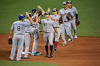 Brett Gardner, Brock Holt, J.D. Martinez, Jose Iglesias high five Mike Moustakas, Brian Dozier, Mark Teixeira after closing out the MLB All-Star Game on July 14, 2015 at Great American Ball Park in Cincinnati, Ohio.  (Mike Janes/Four Seam Images)