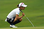 CHON BURI, THAILAND - FEBRUARY 17:  Ai Miyazato of Japan lines up a putt on the 9th green during day two of the LPGA Thailand at Siam Country Club on February 17, 2012 in Chon Buri, Thailand.  Photo by Victor Fraile / The Power of Sport Images