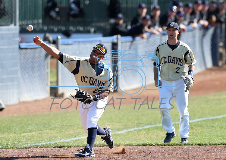 UC Davis' Evan Heptig watches as Steven Patterson makes a play in a college baseball game between the Washington Huskies and the UC Davis Aggies in Davis, Ca., on Sunday, Feb. 17, 2013. Davis won 7-5 to finish their season opening series 3-1. .Photo by Cathleen Allison