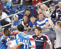 Philadelphia Union forward Freddy Adu (11) collects a quick yellow card after fouling New England Revolution substitute midfielder Kelyn Rowe (11). In a Major League Soccer (MLS) match, the New England Revolution tied Philadelphia Union, 0-0, at Gillette Stadium on September 1, 2012.