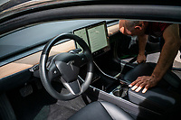 NEWPORT, NJ - AUGUST 31:  A TESLA car is cleaned on August 31, 2020 in Newport, New Jersey. Tesla shares are more affordable today after their split, which does not make the stock a more attractive investment than it was pre-split price. (Photo by Eduardo MunozAlvarez/VIEWpress)