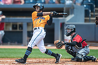 Akron RubberDucks shortstop Jose Fermin (1) follows through on his swing on June 27, 2021 against the Erie SeaWolves at Canal Park in Akron, Ohio. (Andrew Woolley/Four Seam Images)
