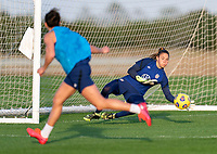 ORLANDO, FL - JANUARY 21: Carli Lloyd #10 of the USWNT has her shot saved by Aubrey Bledsoe #21 during a training session at the practice fields on January 21, 2021 in Orlando, Florida.