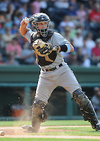 Catcher Dustin Garneau (15) of the Asheville Tourists, Class A affiliate of the Colorado Rockies, in a game against the Greenville Drive on May 1, 2011, at Fluor Field at the West End in Greenville, S.C. Photo by Tom Priddy / Four Seam Images