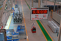 Workers on the production line of the Honda Accord at the new Guangzhou Honda Automobile Co. Ltd. factory. The plant built at a cost of 140 million US$ is one of the most advanced car plants in the world. It has a state of the art production line as well as the world's first total water re-cycling sytem..