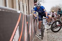 Florian Sénéchal (FRA/Deceuninck - Quick Step) needing to use the barriers as Stefan Küng (SUI/Groupama - FDJ) crashes up the Oude Kwaremont<br /> <br /> 105th Ronde van Vlaanderen 2021 (MEN1.UWT)<br /> <br /> 1 day race from Antwerp to Oudenaarde (BEL/264km) <br /> <br /> ©kramon