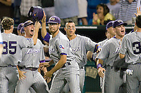 TCU's bench celebrates after Taylor Featherston's 3 run triple in Game 6 of the NCAA Division One Men's College World Series on Monday June 21st, 2010 at Johnny Rosenblatt Stadium in Omaha, Nebraska.  (Photo by Andrew Woolley / Four Seam Images)