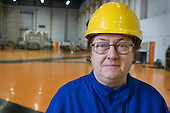A cleaner in the turbine hall of Helsinki Energy, the municipally-owned company which supplies 90% of the Finnish capital's electricity.