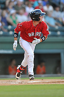 Catcher Austin Rei (13) of the Greenville Drive runs out a fly in a game against the Greensboro Grasshoppers on Thursday, July 14, 2016, at Fluor Field at the West End in Greenville, South Carolina. Greenville won, 3-1. (Tom Priddy/Four Seam Images)