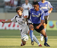 Luchi Gonzalez battles Ricardo Clark for the ball. The San Jose Earthquakes defeated the Colorado Rapids 1-0 at Spartan Stadium in San Jose, CA on June 29, 2005.