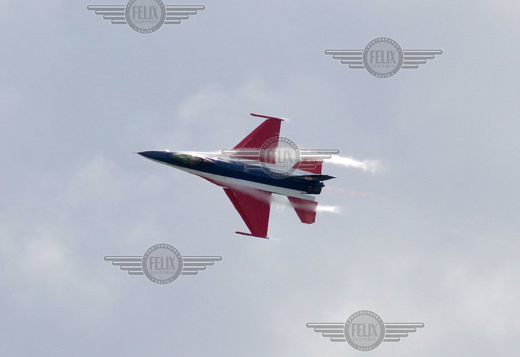 Norwegian F-16 piloted by Eskild Amdal performs a display during Tiger Air show.  Nato Tiger Meet is an annual gathering of squadrons using the tiger as their mascot. While originally mostly a social event it is now a full military exercise. Tiger Meet 2012 was held at the Norwegian air base Ørlandet.