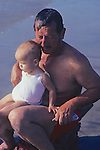 Man And Child At Beach