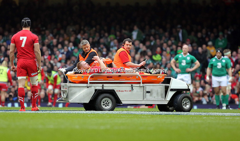 Pictured: Lee Samson of Wales gives the thumbs up as he is taken away by paramedics after getting injured Saturday 14 March 2015<br /> Re: RBS Six Nations, Wales v Ireland at the Millennium Stadium, Cardiff, south Wales, UK.