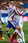 Atletico de Madrid's Joao Miranda and Real Madrid´s Karim Benzema during quarterfinal first leg Champions League soccer match at Vicente Calderon stadium in Madrid, Spain. April 14, 2015. (ALTERPHOTOS/Victor Blanco)