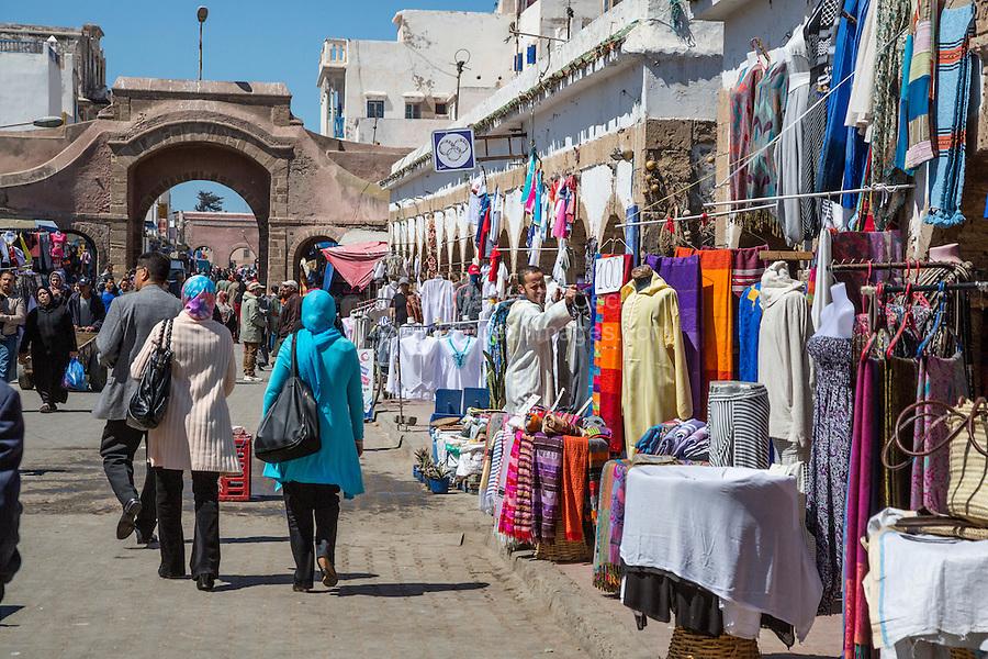Essaouira, Morocco.  Street Scene in the Medina Market, Ave. Mohamed Zerktouni Clothing Vendors.