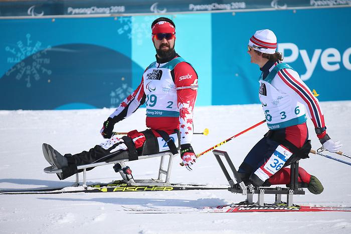 Collin Cameron, Pyeongchang 2018. Para Nordic Skiing // Ski paranordique.<br /> Collin Cameron competes in the men's 7.5km sitting event in Biathlon // Collin Cameron participe à l'épreuve masculine de 7,5 km assis en biathlon. 10/03/2018.