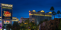 Panorama view of the Las Vegas Strip lit up at twilight, with the Caesar's Palace and The Mirage casino cascades in the foreground, Las Vegas Nevada