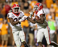 KNOXVILLE, TN - OCTOBER 5: J.R. Reed #20 of the Georgia Bulldogs congratulates Richard LeCounte #2 of the Georgia Bulldogs after his interception during a game between University of Georgia Bulldogs and University of Tennessee Volunteers at Neyland Stadium on October 5, 2019 in Knoxville, Tennessee.