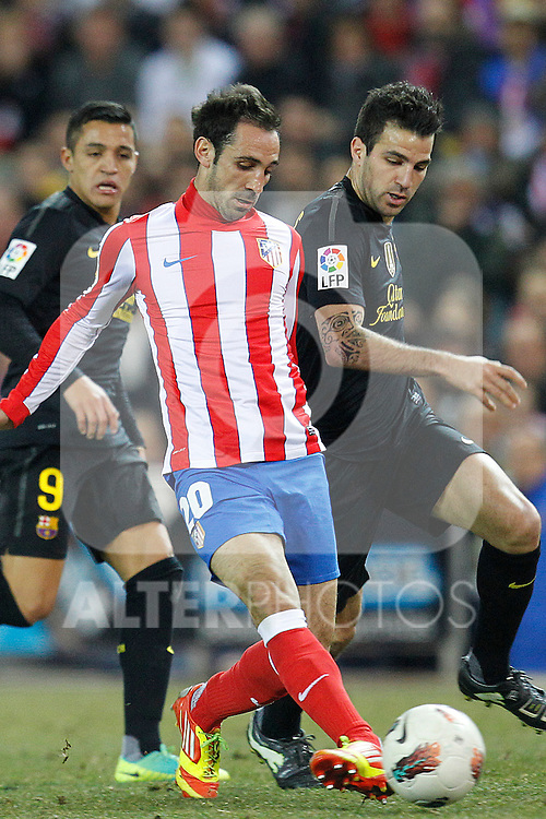 Atletico de Madrid's Juanfran and F.C. Barcelona's Cesc Fabregas during la Liga match on february 26th, 2012. ..Photo: Cesar Cebolla / ALFAQUI