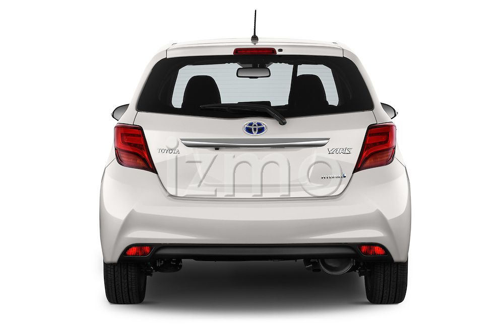 Straight rear view of a 2015 Toyota Yaris Hybride Lounge 5 Door Hatchback 2WD Rear View  stock images