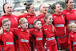 The Wales team along with their children line up for the anthems.<br /> 6 Nations Championship<br /> Wales v Ireland Women<br /> St Helens Swansea<br /> 15.03.15<br /> ©Steve Pope - SPORTINGWALES