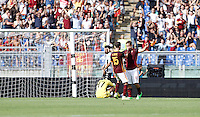 Calcio, Serie A: Roma vs Sassuolo. Roma, stadio Olimpico, 20 settembre 2015.<br /> Roma's Francesco Totti, right, celebrates with teammate Miralem Pjanic after scoring during the Italian Serie A football match between Roma and Sassuolo at Rome's Olympic stadium, 20 September 2015.<br /> UPDATE IMAGES PRESS/Isabella Bonotto