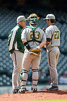 Baylor Bears head coach Steve Smith meets with pitcher Drew Tolson (27) and catcher Matt Menard (23) during Houston College Classic against the Hawaii Rainbow Warriors on March 6, 2015 at Minute Maid Park in Houston, Texas. Hawaii defeated Baylor 2-1. (Andrew Woolley/Four Seam Images)