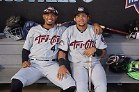 Tri-City ValleyCats Yeuris Ramirez (4) and Juan Paulino (16) in the dugout for a fog delay during a NY-Penn League game against the Brooklyn Cyclones on August 17, 2019 at MCU Park in Brooklyn, New York.  Brooklyn defeated Tri-City 2-1.  (Mike Janes/Four Seam Images)