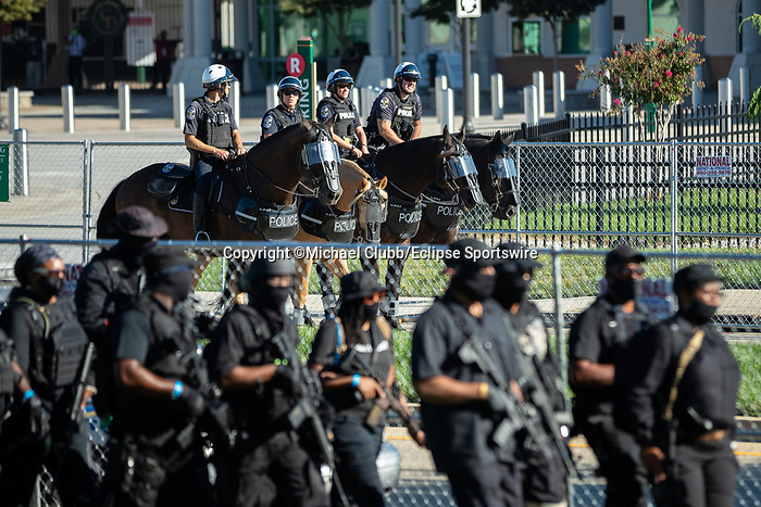 """September 5, 2020: Mounted police watch the NFAC outside of Churchill Downs  the 146th Kentucky Derby. With the Kentucky Derby being the biggest sports event for the State of Kentucky, protestors have chosen the  event as a focal point for their calls for justice in the death of Breonna Taylor. Multiple groups from around the country have converged on Louisville to protest during the """"Run for the Roses"""" at Churchill Downs in Louisville. Michael Clubb/Eclipse Sportswire/CSM"""