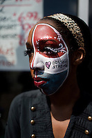 """Lauryn Mooney of Boston painted her face red, white and blue and the words """"Boston Strong."""" She stood opposite the Cathedral of the Holy Cross as President Obama gathered with others on April 18, 2013, 3 days after the bombings at the 2013 Boston Marathon."""