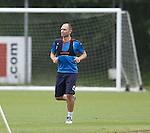 John Eustace training at Rangers as he does laps of the park