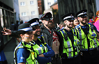 A man dressed in a leather outfit poses for a picture with local police officers as he joins thousands of people in this year's Pride Parade in the centre of Cardiff, Wales, UK. Sayurday 26 August 2017