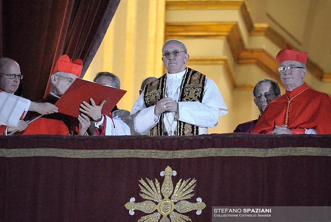 Argentina's Jorge Bergoglio, elected Pope Francis  waves from the window of St Peter's Basilica's balcony after being elected the 266th pope of the Roman Catholic Church on March 13, 2013 at the Vatican.
