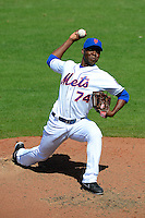 New York Mets pitcher Rafael Montero #74 delivers a pitch during an exhibition game against the Michigan Wolverines at Tradition Field on February 24, 2013 in Port St Lucie, Florida.  New York defeated Michigan 5-2.  (Mike Janes/Four Seam Images)
