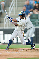 DeAngelo Mack #11 of the Charleston RiverDogs follows through on his swing against the Kannapolis Intimidators at Fieldcrest Cannon Stadium May 29, 2010, in Kannapolis, North Carolina.  Photo by Brian Westerholt / Four Seam Images