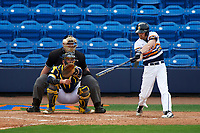 Canisius College Golden Griffins right fielder Adam Tricarico (11) at bat in front of catcher Harrison Wenson (7) and umpire Robert Lothian during the first game of a doubleheader against the Michigan Wolverines on February 20, 2016 at Tradition Field in St. Lucie, Florida.  Michigan defeated Canisius 6-2.  (Mike Janes/Four Seam Images)