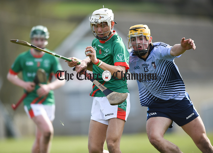 Thep Fitzpatrick of St Fergal's College in action against Mark Rodgers of Scariff Community College during their All-Ireland Colleges final at Toomevara. Photograph by John Kelly.