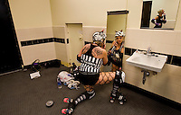 A roller girl puts on her makeup in the locker room during a Charlotte Roller Derby Girls event at Bojangles Arena in Charlotte, NC.
