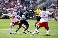 Dax McCarty (11) of the New York Red Bulls defends the ball as Freddy Adu (11) of the Philadelphia Union attempts to split the defense during a Major League Soccer (MLS) match at PPL Park in Chester, PA, on May 13, 2012.