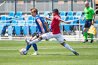 SAN JOSE, CA - APRIL 24: Jackson Yueill #14 of the San Jose Earthquakes evades a tackle by Bryan Acosta #8 of FC Dallas during a game between FC Dallas and San Jose Earthquakes at PayPal Park on April 24, 2021 in San Jose, California.