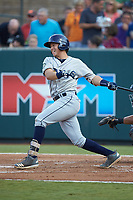 Roberto Alvarez (13) of the Princeton Rays follows through on his swing against the Pulaski Yankees at Calfee Park on July 14, 2018 in Pulaski, Virginia. The Rays defeated the Yankees 13-1.  (Brian Westerholt/Four Seam Images)