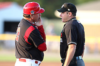 Batavia Muckdogs manager Dann Bilardello #32 argues a call with umpire Brian Lilly during a game against the Tri-City ValleyCats at Dwyer Stadium on July 14, 2011 in Batavia, New York.  Batavia defeated Tri-City 6-3.  (Mike Janes/Four Seam Images)